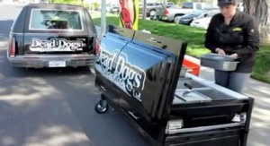 Vendor sells hots out of a hearse and coffin, video still (© Karen T Boucher/2012 Bay Area News Group, http://aka.ms/deaddogs)